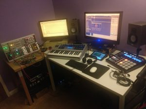 A music studio with keyboards and synthesizers